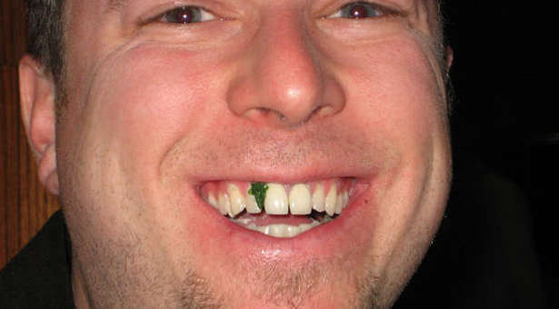 Wouldn't you tell someone right away when they have spinach caught in their teeth?